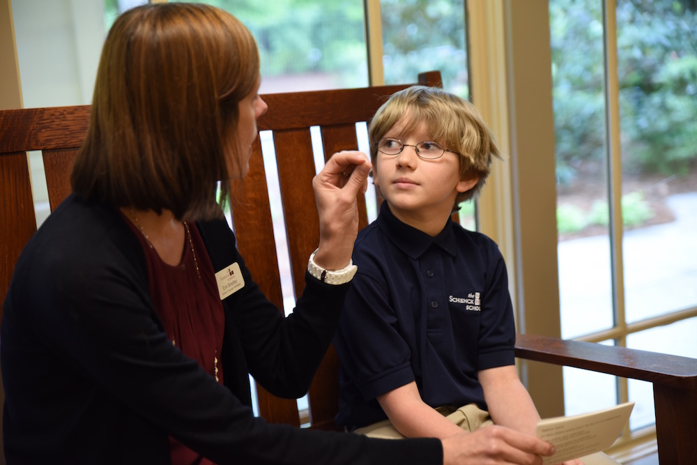 speech-language therapist working with boy one-on-one