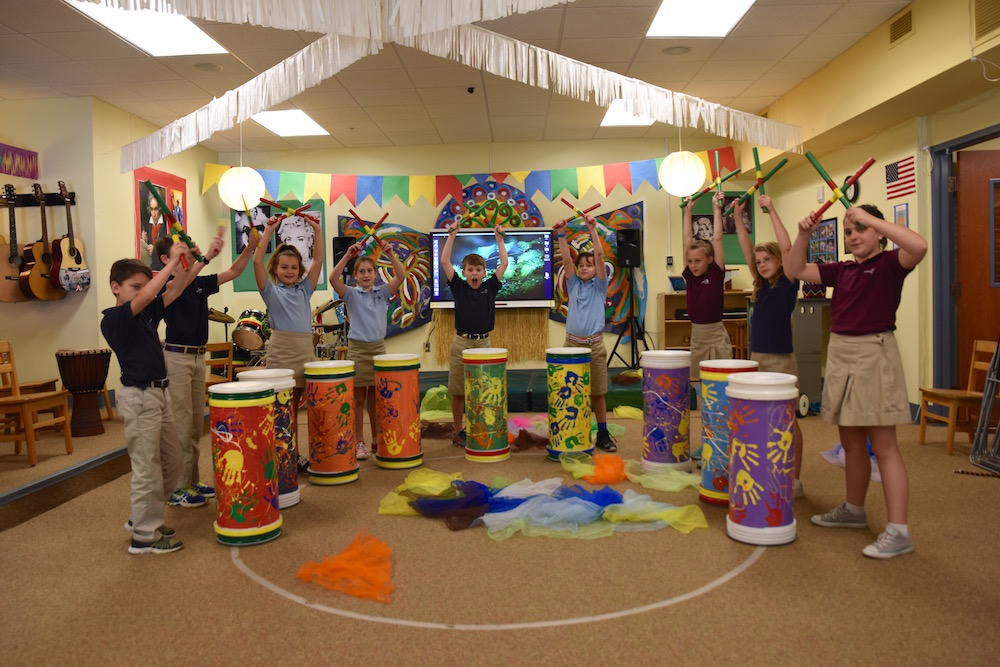 kids playing drums in music room